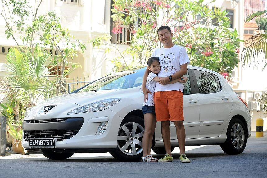 Physical education teacher Loke Kok Fei's interest in car grooming has rubbed off on his daughter Kayen, who helps him wash his Peugeot on weekends.