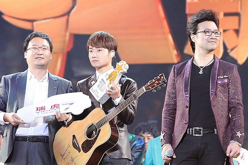 LEFT: Nathan Hartono (right) performing with his mentor Jay Chou at the Sing! China final yesterday. The Singaporean picked two of his mentor's classics - singing the Nunchucks rap hit with Chou and the Longest Movie ballad by himself. RIGHT: Winner