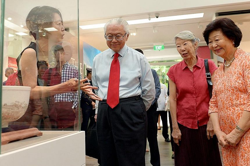 President Tan and his wife Mary with Ms Constance Sheares, daughter of former president Benjamin Sheares, on a tour of the gallery led by NHB's director of preservation of sites and monuments Jean Wee.