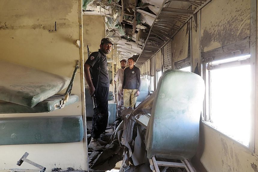 Pakistani security officials inspecting the site of an explosion in a Jaffer Express train in the Much area of Quetta, capital of Balochistan province, yesterday. According to reports, train services were disrupted and five people were killed and 20
