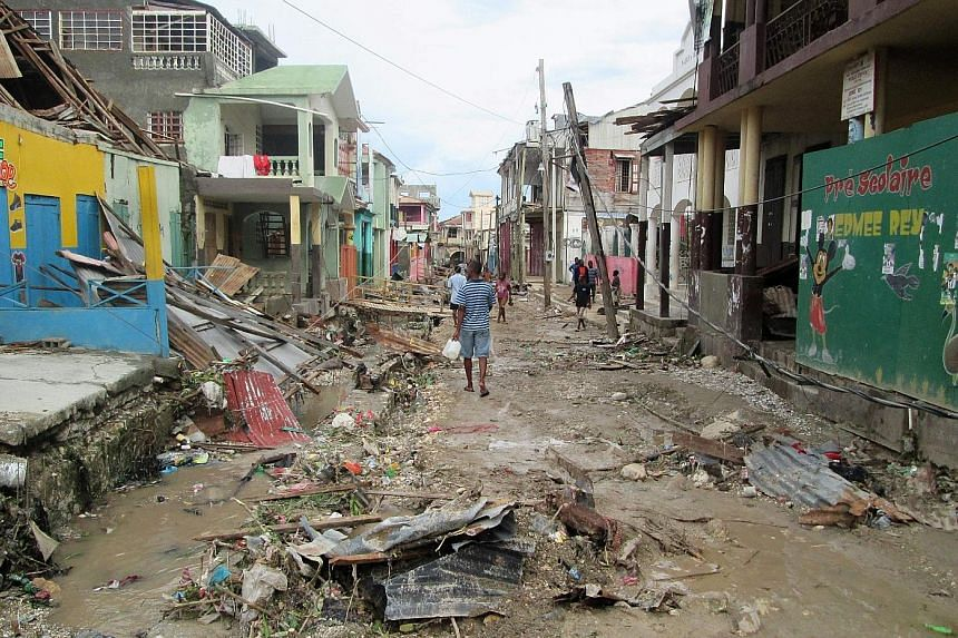The damage wreaked by Hurricane Matthew in the town of Jeremie in west Haiti. The death toll in the country surged to at least 572 people yesterday.