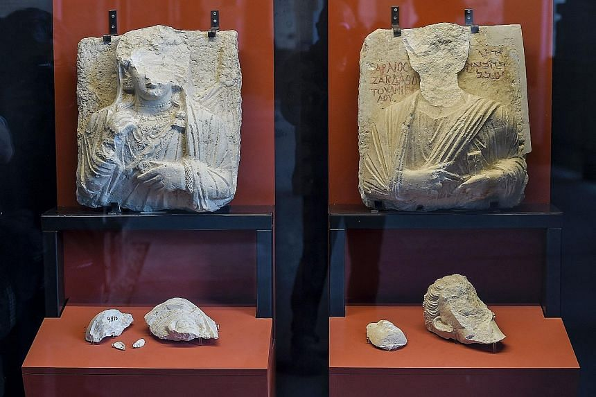 Above: Two busts whose faces were hammered away by ISIS members at the Palmyra museum in Syria, now part of an exhibition at the Colosseum in Rome. Right: The recreated human-headed winged bull from the Northwest Palace in Nimrud, Iraq, at the exhibi