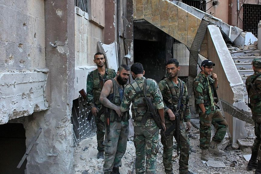 Syrian pro-government soldiers in a rebel-held Aleppo neighbourhood this week. The battle for eastern Aleppo has raised tensions between the United States and Russia to their highest levels in years, but the Cold War rivals do not wield clear control