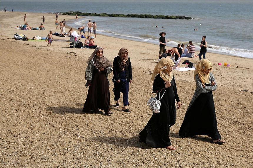Foreigners enjoying the beach in Clacton-on-Sea, a town in eastern England. British Prime Minister Theresa May has interpreted Britain's 52 per cent to 48 per cent referendum outcome as an anti-immigration message that gives her a mandate to enact st