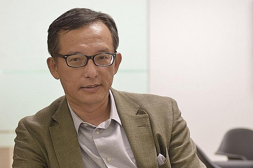 ASSOCIATE PROFESSOR SIMON TAY Chairman of the Singapore Institute of International Affairs