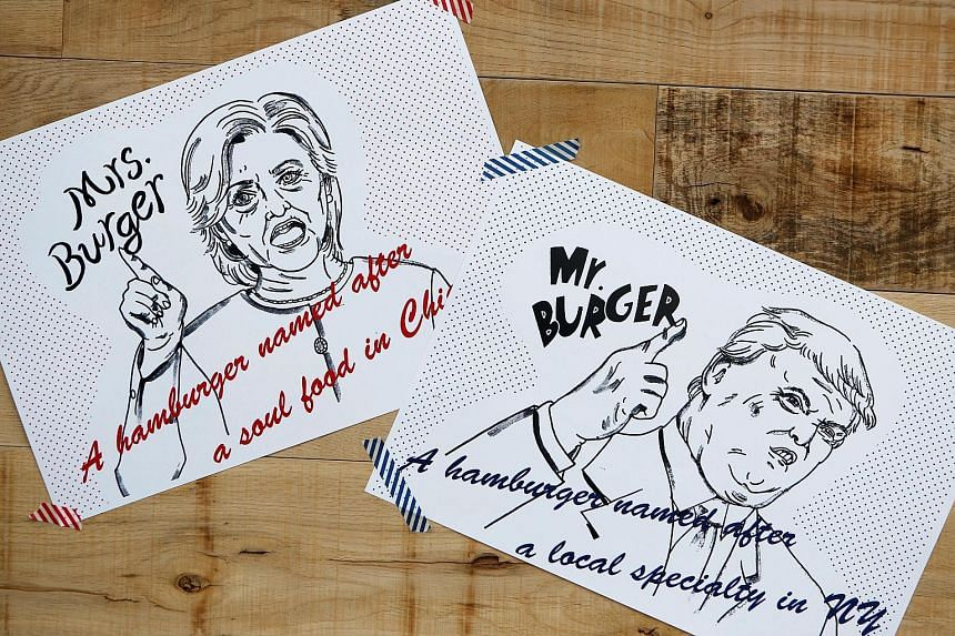 Posters depicting the presidential candidates as Mr and Mrs Burger in a burger cafe in Tokyo.