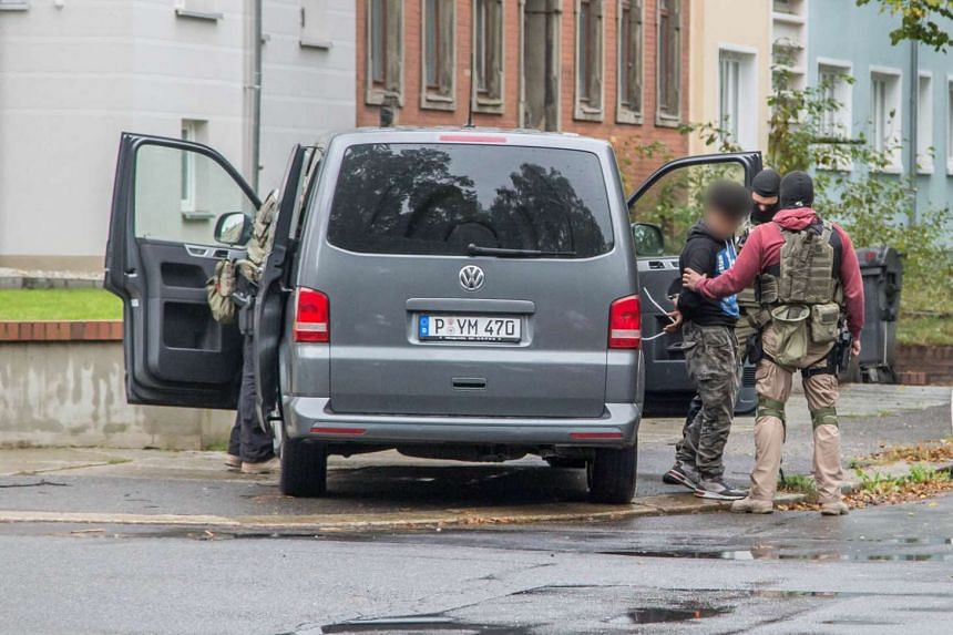 Police arrest a person at a residential area in Chemnitz, eastern Germany, on Oct 8, 2016.