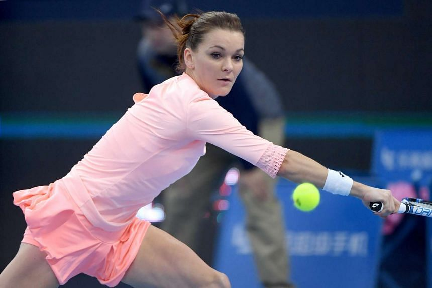 Agnieszka Radwanska of Poland hits a return against Johanna Konta of Britain during the women's singles final of the China Open tennis tournament in Beijing on Oct 9, 2016.