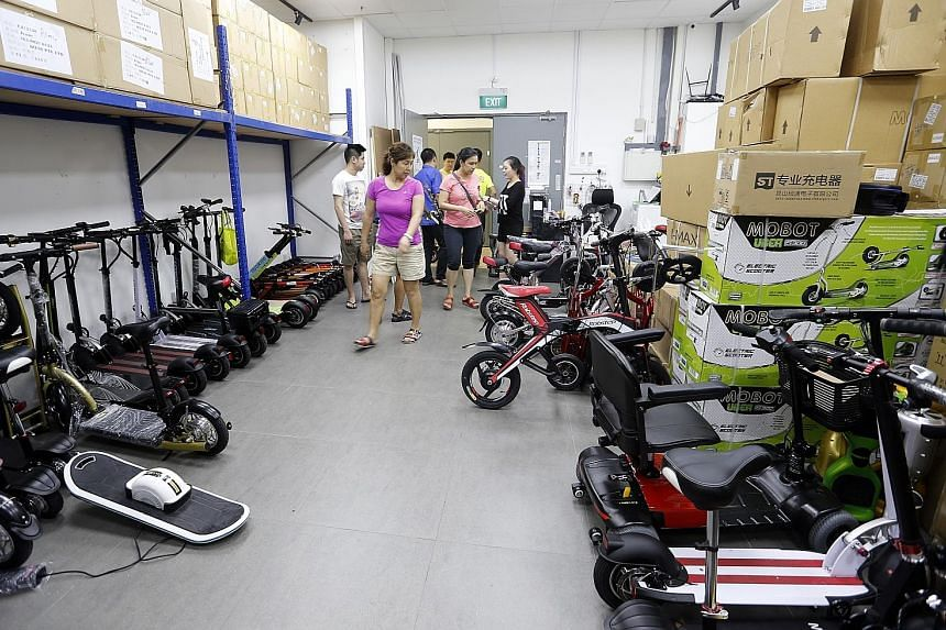 An array of mobility devices at Mobot's showroom in Ubi. The retailer says it sells more than 400 e-scooters a month, a 30 per cent increase since stricter e-bike rules took effect last December.