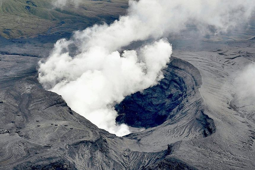 An aerial view of Mount Aso erupting in Aso, Kumamoto prefecture, Japan yesterday. The Japan Meteorological Agency has raised the alert level for the volcano to level three on a scale of five.