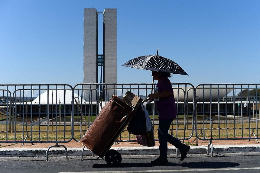 A street vendor walking past the National Congress during Brazilian President Dilma Rousseff's impeachment trial in August. The Brazilian equity market has seen a strong performance since her ouster.