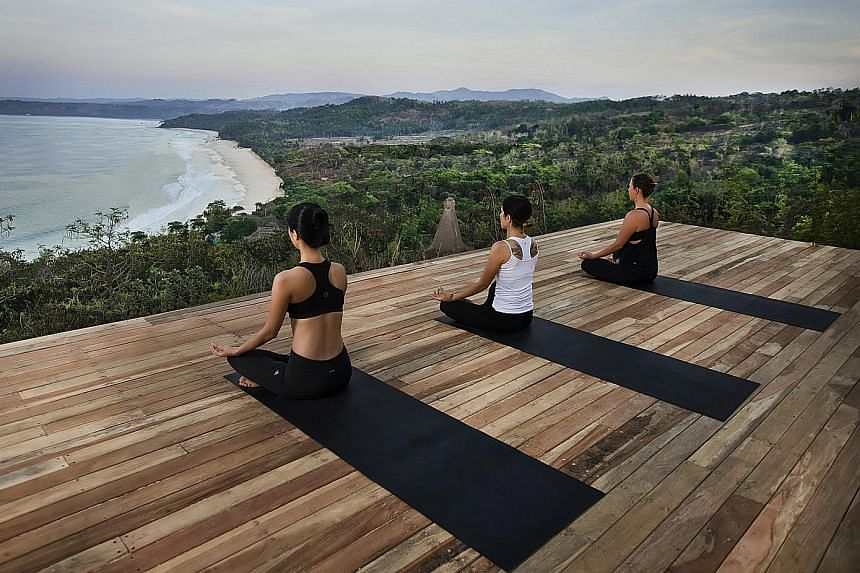 A yoga session (above) at the Nihiwatu Resort on Indonesia's Sumba Island. Customers entitled to Dynasty Travel's Christmas Comes Early lucky draw stand a chance to win a Celebrity Cruise to Alaska (left).