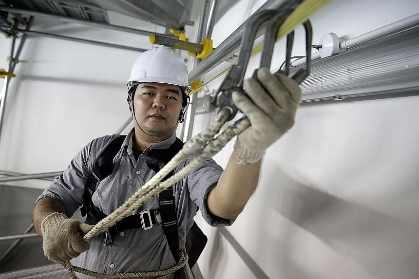 Workplace safety and health trainer Han Wenqi believes safety officers should be empowered to order work to stop at once when they see something dangerous on site.