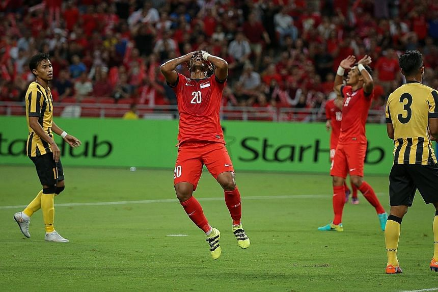 Singapore midfielder Izzdin Shafiq reacting to a missed opportunity against Malaysia in the Causeway Challenge on Friday.