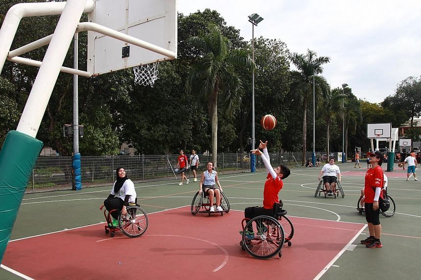 Able-bodied participants such as 16-year-old Jaslyn Song (centre, in light blue) had their chance to experience playing wheelchair basketball at the ROMP youth sports carnival.