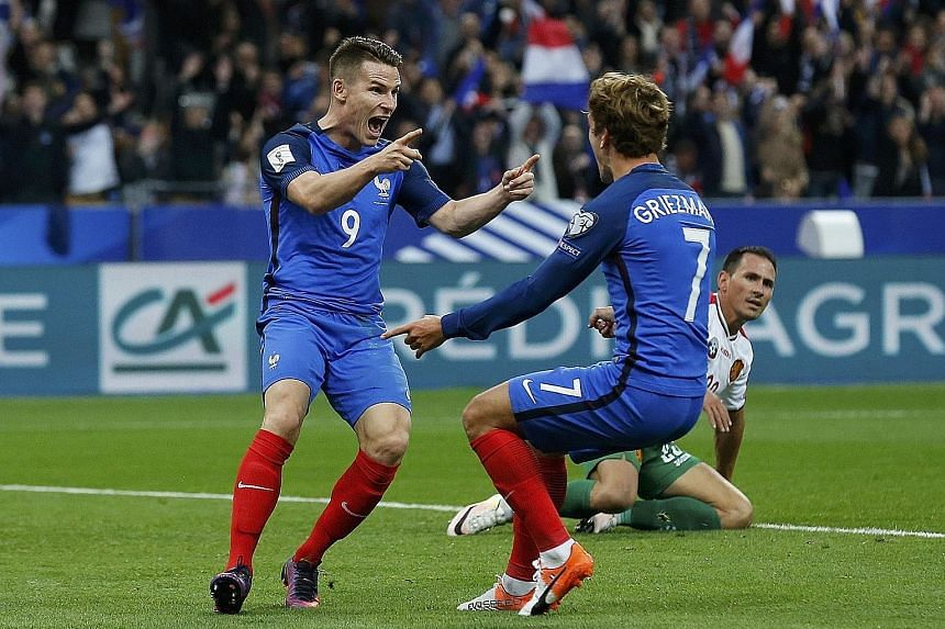 Two-goal hero Kevin Gameiro (left) celebrating his feat with strike partner Antoine Griezmann as France swept to a 4-1 win over Bulgaria.