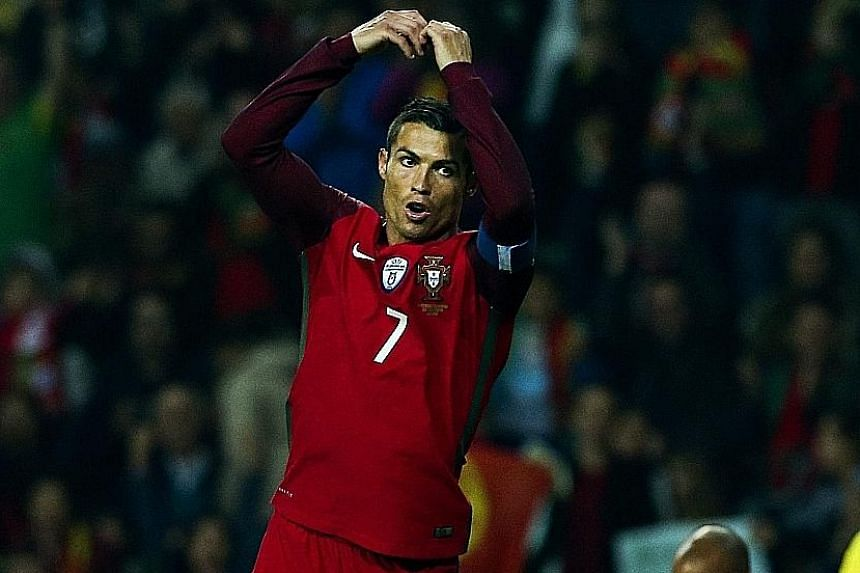 A familiar sight for Portugal fans, as Cristiano Ronaldo celebrates in his unique style after scoring four past Andorra. The four goals bring his international goal tally to 65 in 134 appearances.