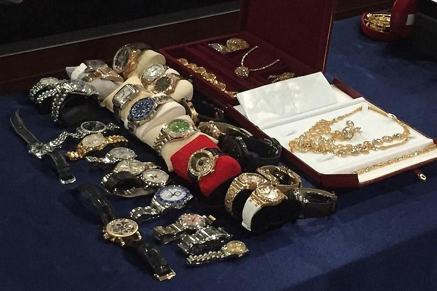 Other than cash, luxury brand watches, rings and necklaces were seized from the homes and offices of the two senior officials in Sabah's water department.