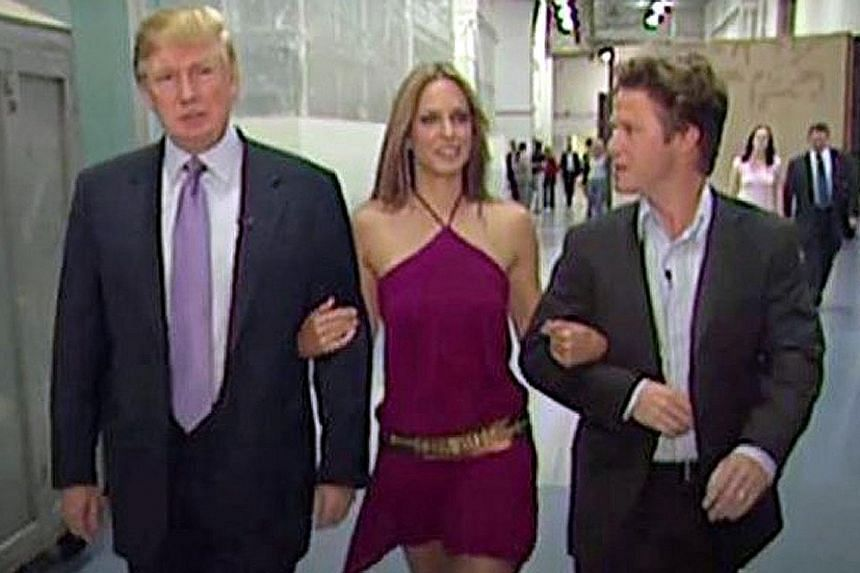 """Mr Trump with actress Arianne Zucker and Mr Bill Bush in the 2005 video. Mr Bush has apologised for """"playing along"""" in the video where Mr Trump made lewd and disrespectful comments about women."""