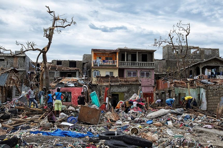 Some 61,500 people are in shelters, Haiti officials said, after Hurricane Matthew hurled the sea into fragile coastal villages, some of which are only now being contacted. Aerial footage from the hardest-hit towns shows a ruined landscape of metal sh