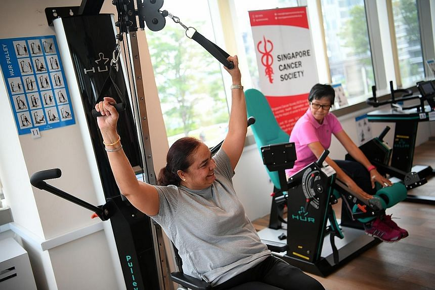 Lymphoma survivor Rajwant Kaur (far left) exercising at the gym at the Singapore Cancer Society's rehabilitation centre in Jurong East, which was officially launched yesterday. She credits her stronger body to the programme that the centre customised