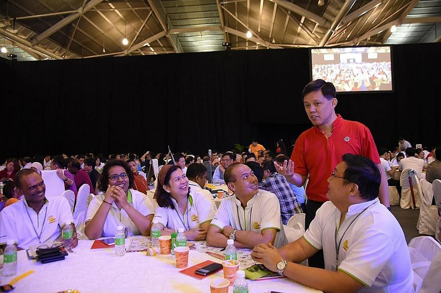 "Mr Chan (in red) with grassroots leaders at the Singapore Expo. He described civic and volunteer groups as part of a ""second wing"" network, that is not part of the PA's traditional grassroots network but forms part of the social fabric. ""Only when th"