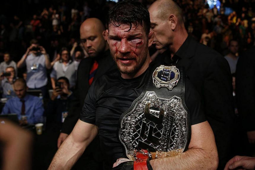 Michael Bisping of England celebrates winning his fight.