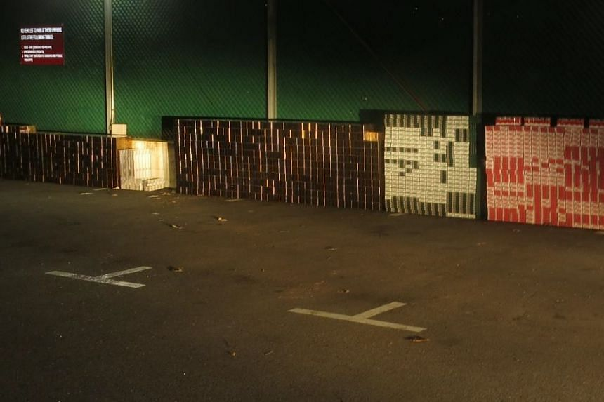 A total of 2,390 cartons and 100 packets of cigarettes were found in the two men's vans.