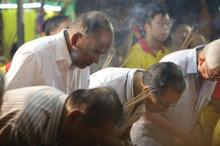Mr Shanmugam bowing as prayers are offered during the Festival of the Nine Emperor Gods, on Oct 9, 2016.