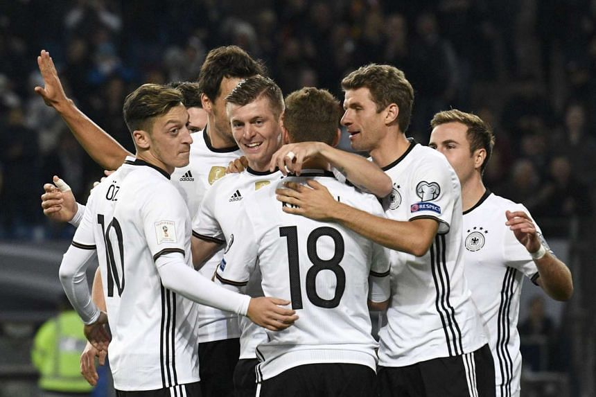Germany's players react during the qualifier.