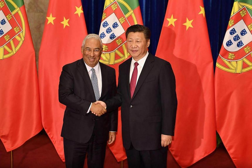 Chinese President xi Jinping (right) shakes hands with Portuguese Prime Minister Antonio Costa before their meeting at Beijing's Great Hall of the People.