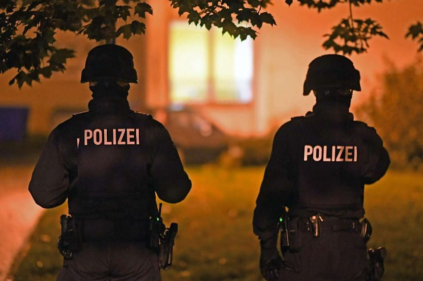 German police officers standing guard near a sealed-off residential area in Chemnitz, Saxony, on Oct 8, 2016.