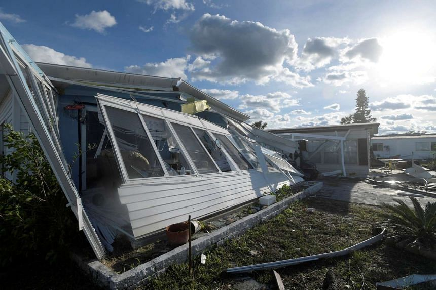 Damaged homes are seen in the aftermath of Hurricane Matthew at the Surfside Estates neighbourhood in Beverly Beach, Florida, on Oct 8, 2016.