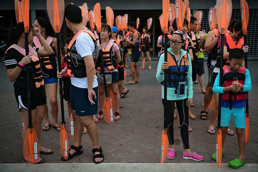 Participants lining up to take part in a free kayaking session at the Water Sports Centre Community Day on Oct 9, 2016.
