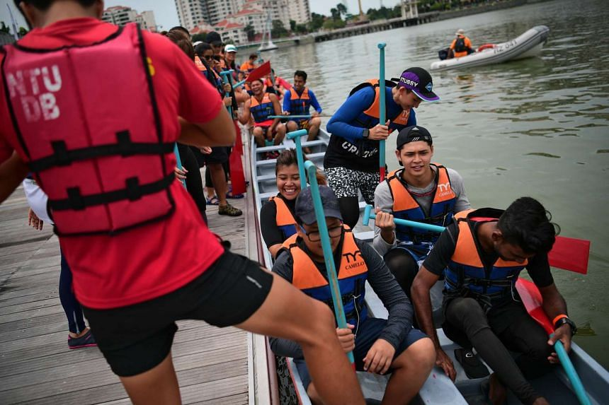 Participants from KK Hospital and their families preparing to go dragonboating at the Water Sports Centre Community Day on Oct 9, 2016.