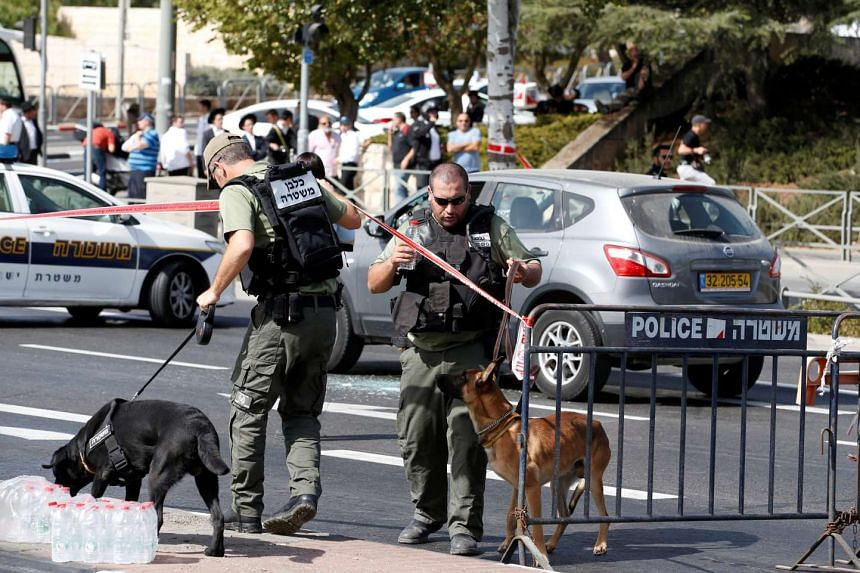 Israeli police secure the area following a shooting incident near police headquarters in Jerusalem on Oct 9, 2016.