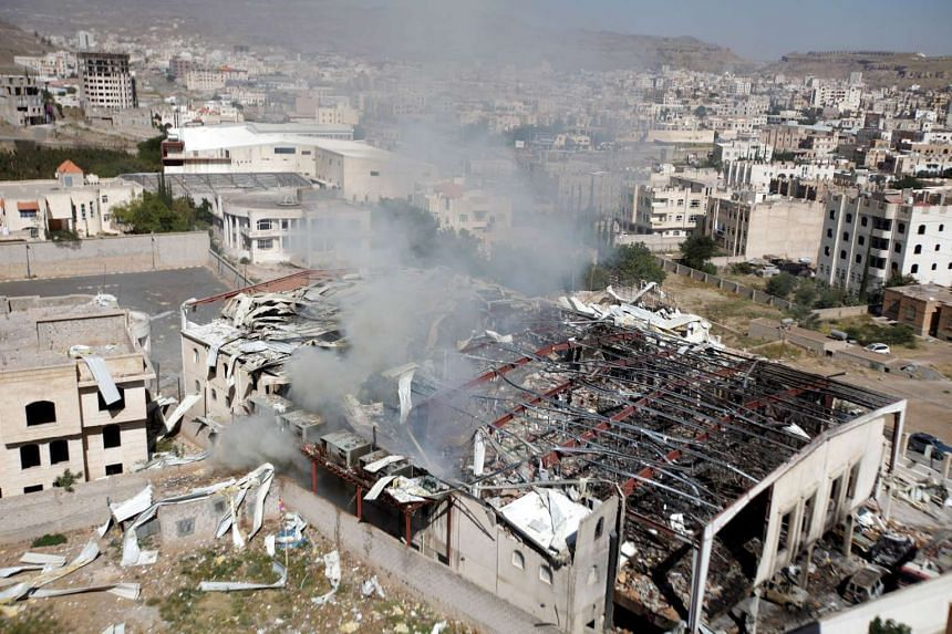 Smoke rises from the community hall where Saudi-led warplanes struck a funeral in Sanaa, the capital of Yemen on Oct 9, 2016.