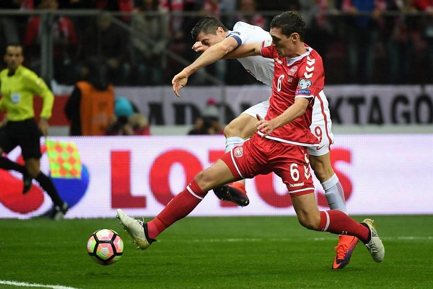 Poland's Robert Lewandowski (left) fights for the ball with Andreas Christensen (right) of Denmark during Fifa World Cup 2018 Qualification soccer match between Poland and Denmark on Oct 8, 2016.