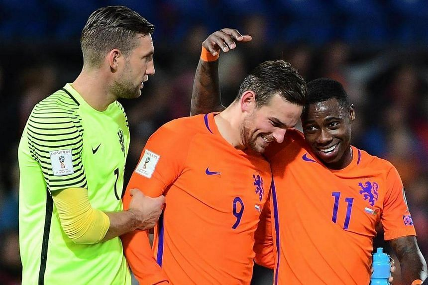 Netherlands' Quincy Promes (right) and Netherlands' Vincent Janssen (centre) celebrate after their team's victory during the FIFA World Cup 2018 qualification football match between The Netherlands and Belarus on Oct 7, 2016.