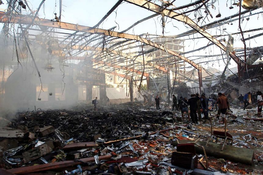 A picture taken on Oct 8, 2016 shows a general view of the destruction following reported airstrikes by Saudi-led coalition air-planes on a building in the capital Sanaa.