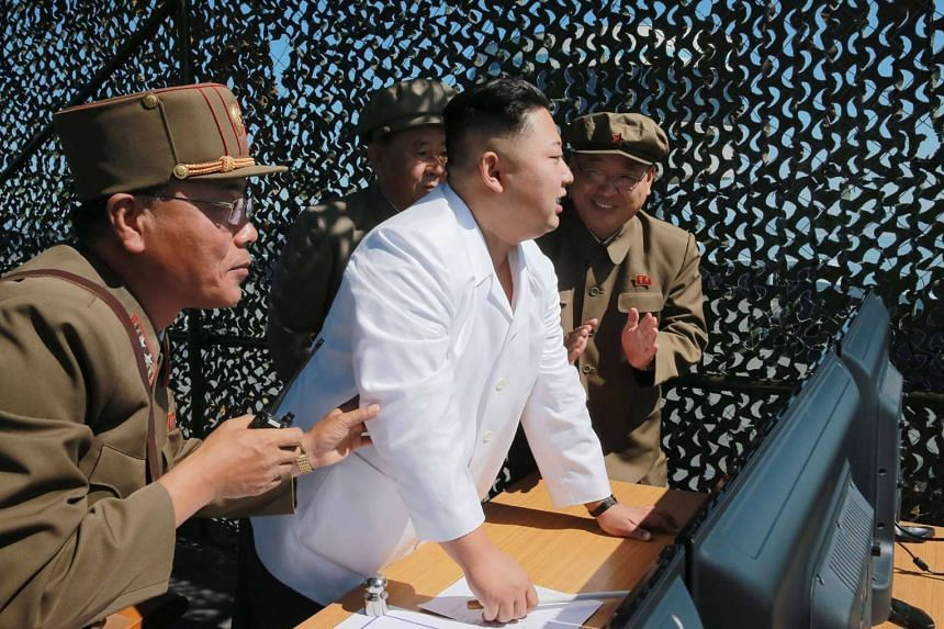 North Korean leader Kim Jong-Un (centre) visiting the Sohae Space Centre in North Korea in an undated photo.