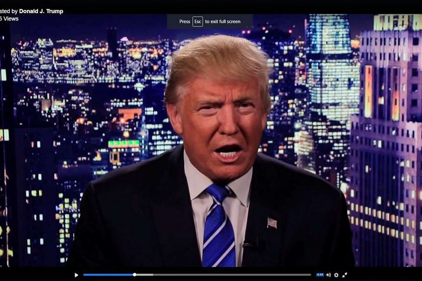 Trump is seen in a video screengrab as he apologises for lewd comments he made about women.