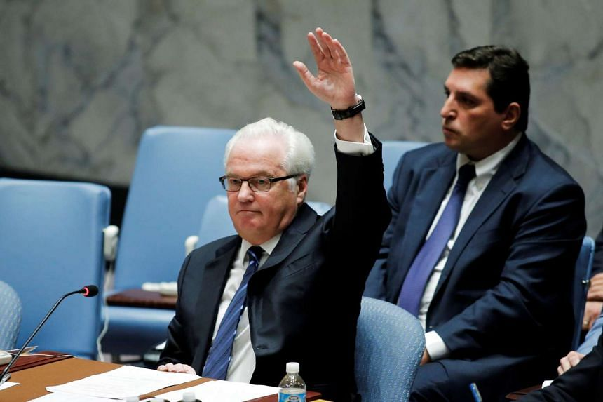 Russia Ambassador Vitaly Churkin vetoes a draft resolution that demands an immediate end to air strikes and military flights over Syria's Aleppo city.