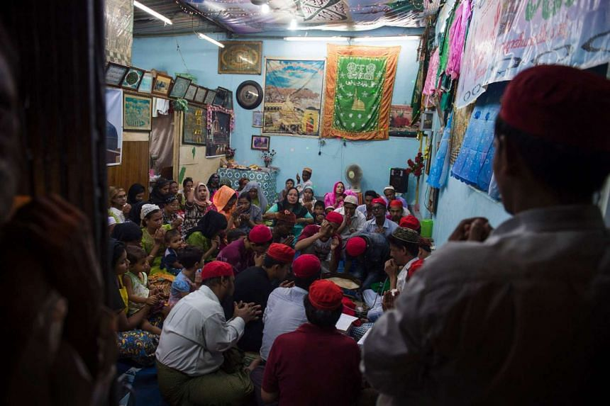 Myanmar Muslims gather for a religious event at a family-owned apartment located in the old section of Yangon on Sept 24, 2016.