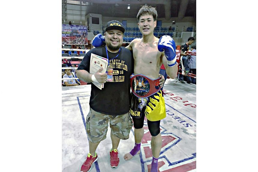 Terrence Teo (right) with his coach Arvind Lalwani after capturing his third championship belt on Oct 8, 2016.