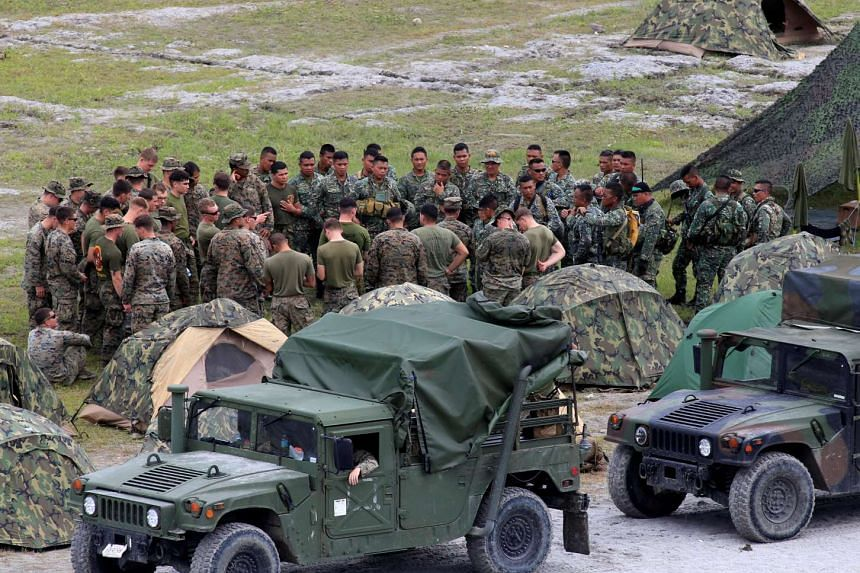 US-Philippine military forces gather before their start of the annual Philippines-US live fire amphibious landing exercise at Crow Valley in Capas, Tarlac province, Philippines on Oct 10, 2016.