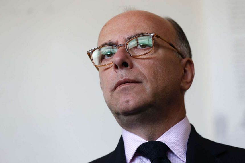 French Interior Minister Bernard Cazeneuve speak to the press during a visit to the police station of Savigny-Sur-Orge in Paris on Oct 10, 2016.