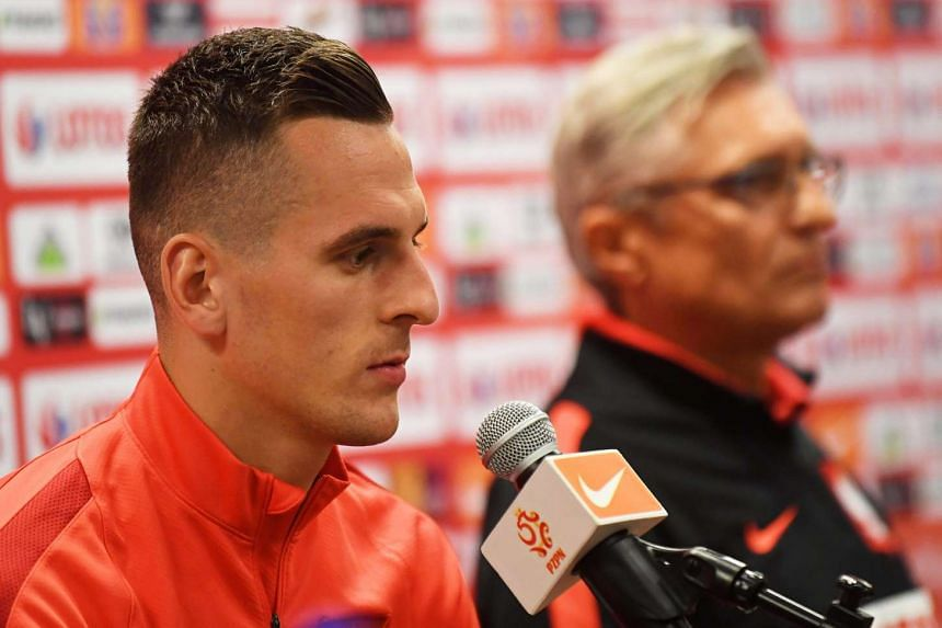 Polish national soccer team head coach Adam Nawalka (right) and striker Arkadiusz Milik (left) attend a press conference in Warsaw, Poland, on Oct 7, 2016.