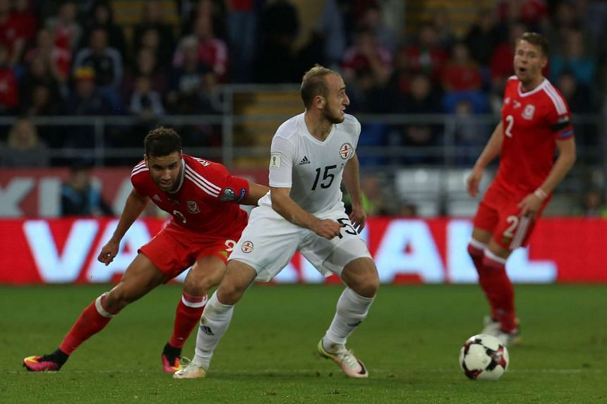 Georgia's midfielder Valeri Gvilia (centre) vies with Wales's striker Hal Robson-Kanu (left) during the World Cup 2018 football qualification match between Wales and Georgia at Cardiff City Stadium in Cardiff, south Wales on Oct 9, 2016.