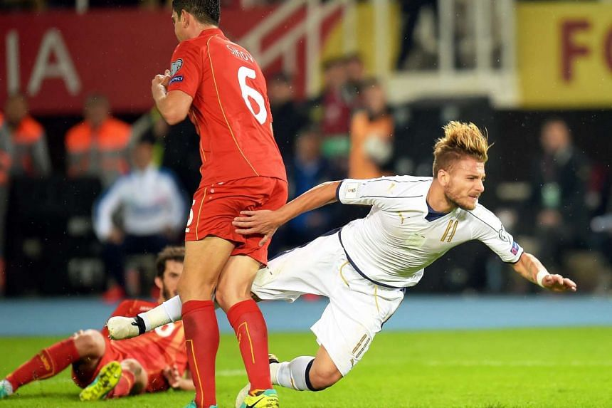 Ciro Immobile (rigth) of Italy in action against Vance Sikov (left) of Macedonia during the Fifa World Cup 2018 qualifying soccer match between Macedonia and Italy at the Filip II Arena in Skopje, The Former Yugoslav Republic of Macedonia, on Oct 9,